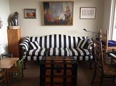 black and white striped furniture. black and white striped camelback sofa via decked studios interiors furniture