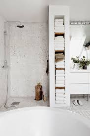 tile africa bathroom ideas. this all white bathroom not only has a large tub and an open shower but built in storage for the linens towels. tile africa ideas o