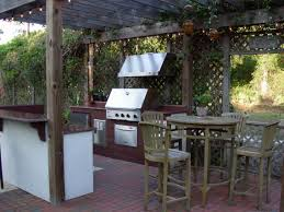 patio outdoor stone kitchen bar: splendid outdoor kitchen  impressive outdoor living with rustic wooden dining room and modular kitchen with red tiles base finish plus stainless steel grill as well as red paved stone floor and wooden canopy roof style ideas g