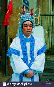 paris france portrait belleville chinatown chinese man in make up and costume posing chinese new year
