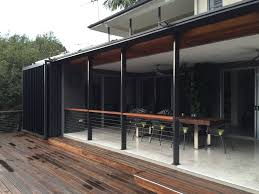 recessed tracks in the decking allow uninterrupted use of the area when the doors are open and privacy and weather protection when they are closed