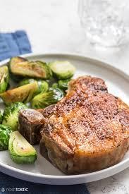 Parmesan crusted pork chops are tender and juicy! Easy Air Fryer Pork Chops Keto Paleo W30 Noshtastic
