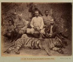 photo of men posing with hunting equipment