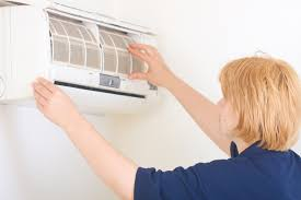air conditioning cleaning. replacing or cleaning air conditioner filters is a critical maintenance task. | photo courtesy of conditioning s