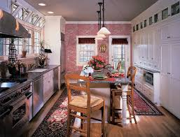 pink fl wallpaper kitchen rugs white cabinets and island wooden chairs black granite countertop light wood flooring