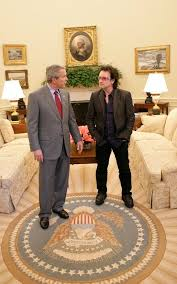bush oval office. President George W. Bush And Bono Discuss Global AIDS Africa Policy In The Oval Office Wednesday,