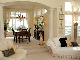 formal dining rooms with columns. this large adjoining living room and dining area is separated by an arched entryway with formal rooms columns