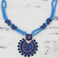 blue ceramic pendant necklace designed by an indian artisan grandiose sky