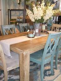 farmhouse dining room with greenish blueish chairs