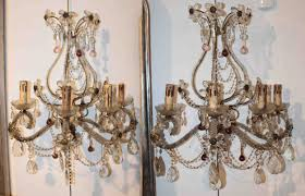 pair of grand crystal wall sconces with crystal flowers