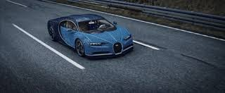Designer aurelien rouffiange and the team had just completed the 1:8 scale model of the chiron and began to debate what the ultimate challenge for the lego technic building system would be. The Amazing Life Size Lego Technic Bugatti Chiron That Drives On Make A Gif