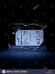 subdued lighting. Computer Hard Drive With Outer Casing Under Subdued Lighting. - Stock Image Lighting S