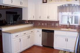 inspiring white color painted kitchen cabinets with granite countertops added dark wood counter