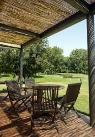 inexpensive covered patio ideas. Modren Covered Covered Patio  Cover The Ugly Metal Awning With Bamboo Fencing With Inexpensive Ideas N