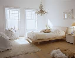 scandinavian master bedroom decorating ideas with classic chandelier and beige carpet