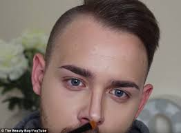 in his video he uses darker makeup to contour his nose and create definition part