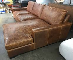 right facing view of this braxton sofa chaise sectional in italian bwood tan leather