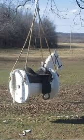 turn a cable spool into this awesome horse swing what a great idea horse swingsaddle swingsaddle rackdiy projectswooden