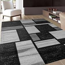 gray white and black reminds me paul mondrian piece of artwork soft and plush to walk on