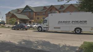 fargo n d a man was killed and two brothers were arrested following a bing at a fargo hotel