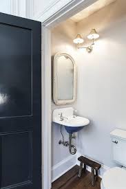 tiny vintage powder room with wall mount sink