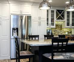 off white cabinets in french vanilla with a dark kitchen island buckboard americana drop leaf