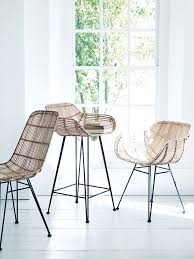 modern rattan furniture. inspired by classic design and material our stylish armed chair has a strong black iron frame woven rattan in tonal shades of blonde contemporary modern furniture