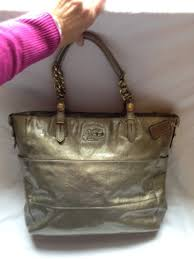 coach gold metallic patent leather purse