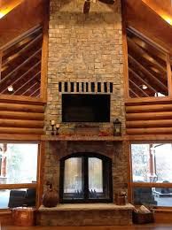 custom see through wood burning indoor outdoor fireplace indoor view