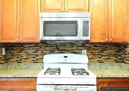 photo id item venetian gold granite with backsplash tile new brown cabinet
