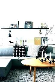 an error occurred shelf behind couch and ledge over with large painting above table mirrored shelf wall