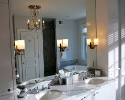 Charming Bathroom Sconce Lighting with Mirror Sconce Next to Wall