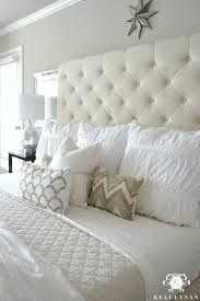 Kelley Nan: Master Bedroom Update- Calming White and neutral master bedroom  with tufted