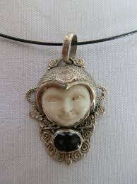 moon face pendant in 925 silver set with black onyx stone faced carved from buffalo