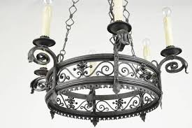 french wrought iron six light chandelier having decorated work throughout this finely made handwork fixture