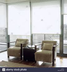 Contemporary Blinds pair of contemporary armchairs in a light living room with white 8942 by guidejewelry.us