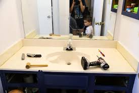 how to replace an ugly bathroom counter it s quick easy and surprisingly affordable