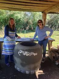 cooking naan in our tandoor