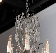 a french rococo revival six light crystal chandelier with pendeloqueetal bobeches from the