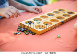 Game With Stones And Wooden Board Ludo Wooden Board Game Stock Photo 100 Shutterstock 38
