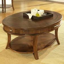 oval wooden table with tiny drawers