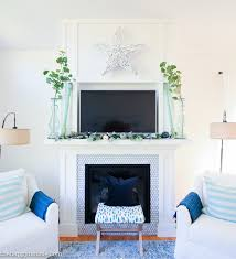 but for now the chairs are in their new position flanking the fireplace and actually i love the clean crisp look i don t miss the extra clutter of the