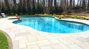saddle riverpool patio modern pool located in norwood this custom designed contemporary pool is flanked b