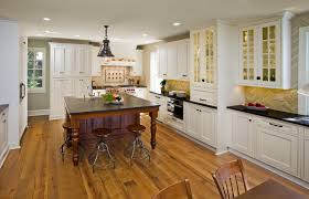 stunning kitchen design ideas with solid wood laminate flooring under large square teak wood kitchen table and white painted oak wood kitchen cabinets which