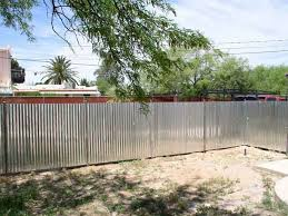Rusted corrugated metal fence Unpainted Chain Fence Gate Rusted Corrugated Metal Areckoning Film Corrugated Metal Fence Tucson Rugs Ideas