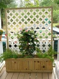 planter boxes with lattice box made from fence boards maybe without the and wheels on bottom planter boxes with lattice