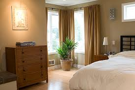 Example of a trendy light wood floor bedroom design in Seattle with beige  walls
