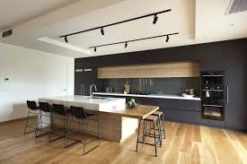 white cabinets with wood countertops honed black