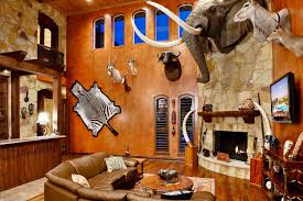 texas hill country 6234 trophy room with mounted animal heads a stone fireplace