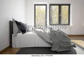bedroom side view. 3d Rendering Of An Unmade Messy Bed In A Modern Bedroom With Balcony Door And Window Side View E